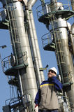 Oil worker in front of oil and fuel towers Royalty Free Stock Photos