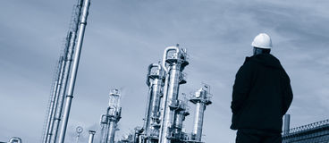 Oil worker and fuel tanks Stock Photo
