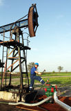 Oil worker with hammer Stock Photos