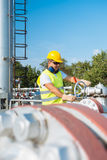 Oil worker in industrial oil Stock Photos