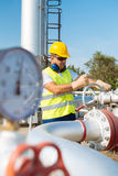 Oil worker in industrial oil Stock Photography