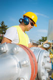 Oil worker in industrial oil Royalty Free Stock Photos