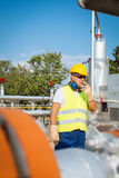 Oil worker in industrial oil Royalty Free Stock Image