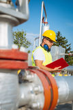 Oil worker in industrial oil Stock Images