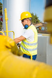 Oil worker in industrial oil Royalty Free Stock Images