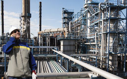Oil worker inside large chemical refinery Royalty Free Stock Image