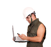 Oil worker with laptop and phone Stock Photography