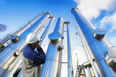 Oil worker with oil and gas pipes. Oil worker with large oil and gas pipes, pipelines Stock Photography