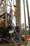 Oil Worker at Oil Well Abandoning Jobsite Stock Image