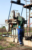 Oil worker with pipe wrench Royalty Free Stock Photos