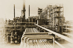 Oil worker with pipelines constructions Stock Photo