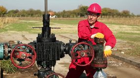 Oil Worker Repairing A Oil Pumping Unit At A Oil Well stock video footage