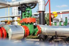 Oil worker repairing wellhead valve Royalty Free Stock Photography