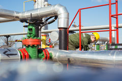 Oil worker repairing wellhead valve Royalty Free Stock Images