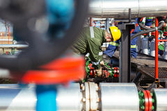 Oil worker repairing wellhead valve with the wrench Royalty Free Stock Photography