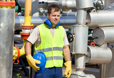 Oil worker. Worker with safety equipment on oil plant Stock Photos