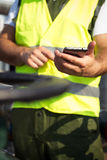 Oil worker using smart phone Royalty Free Stock Photography