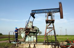 Oil worker working Royalty Free Stock Image