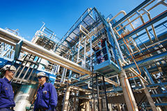 Oil workers and industrial refinery Royalty Free Stock Photography