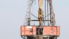 Oil workers on land drilling rig stock video