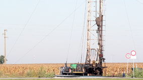 Oil workers with land drilling rig. On oilfield stock video