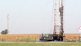 Oil workers. On oilfield with drilling rig stock footage