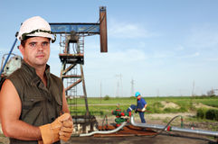 Oil workers on oilfield Royalty Free Stock Images