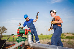 Oil workers Royalty Free Stock Photos