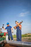 Oil workers Stock Images