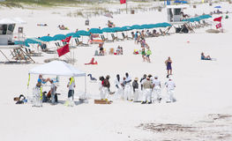 Oil workers replace tourists on Pensacola Beach Stock Image