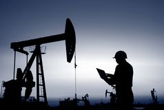 The oil workers are working stock image