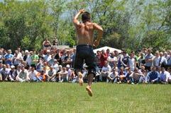 Oil Wrestler dancing Stock Photos