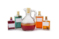 Oilcan and jars. Group of bottles filled with oil over white background Stock Image