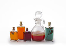 Oilcan and jars. Group of bottles filled with oil over white background Stock Photography