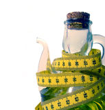 Oilcan with measuring tape. Mediterranean diet is good for your health Royalty Free Stock Images