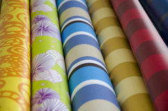 Oilcloth Fabrics with bright patterns. Rolls of oilcloth fabrics with colorful bright patterns for tablecloth royalty free stock image