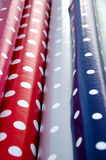Oilcloth Fabrics with bright patterns. Rolls of oilcloth fabrics with colorful bright patterns for tablecloth stock images