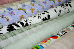 Oilcloth Fabrics with bright patterns Stock Photos