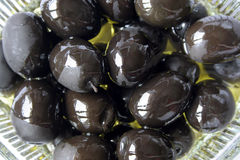 Oiled black olives Stock Images