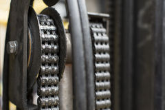 Oiled chain of a forklift truck Royalty Free Stock Images