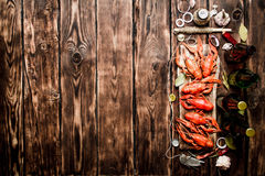 oiled crawfish with beer bottles on the old Board. Stock Photos