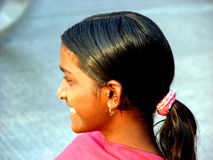 Oiled Hair. An Indian girl with her hair oiled Stock Image