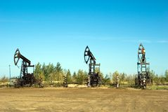Oilfield. Oil wells on a deposit on a background of the blue sky Royalty Free Stock Images