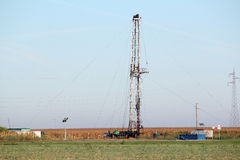 Oilfield with oil drilling rig Royalty Free Stock Image