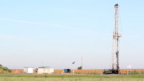 Oilfield with oil drilling rig. And workers stock video footage