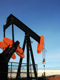 Oilfield Pump Jack. A pump jack stands alone on the prairies Royalty Free Stock Image