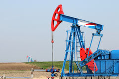 Oilfield with pump jack Royalty Free Stock Photos