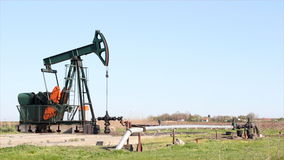 Oilfield with pump jack stock video footage