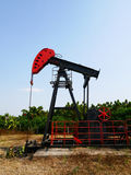 Oilfield Pump jack rocking horse or pumpjack over a wellhead Royalty Free Stock Photos