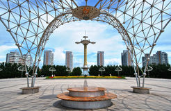 Oilfield Square(DaQing,China). The Oilfield Square, DaQing,HeiLongjiang, China .Steel sculpture like a frame around the middle statue of the square. Also, the Stock Photo
